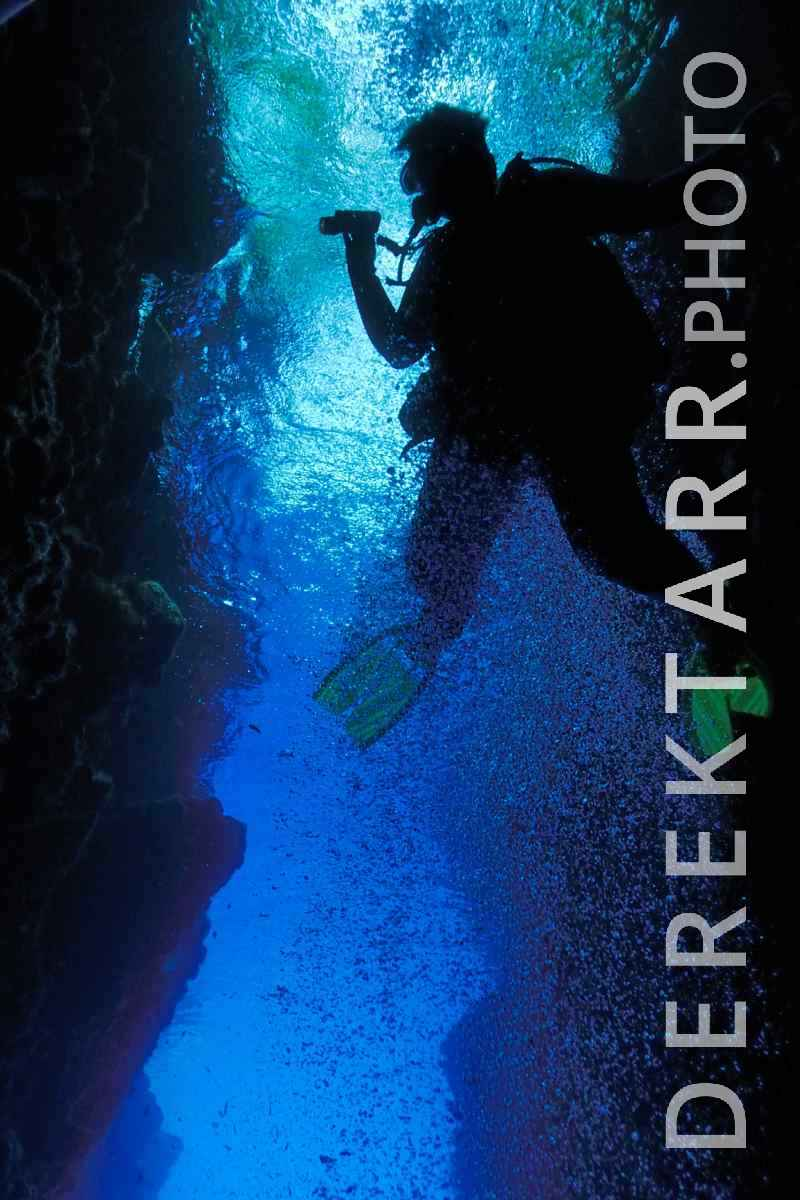 large view of Scuba Diver Explores Leru Cut