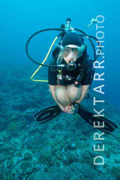 Hovering Female Scuba Diver