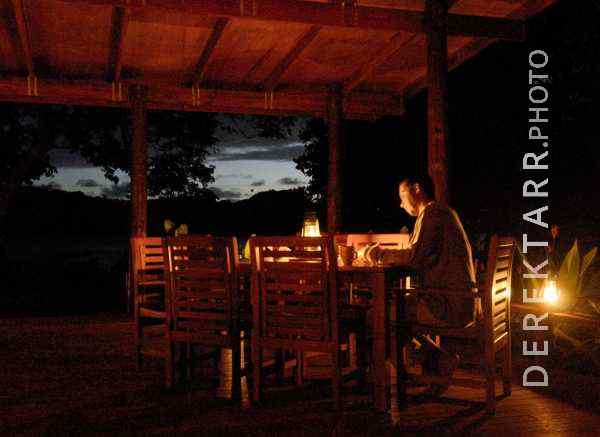 Man Relaxing After Dark at Matava Main Bure