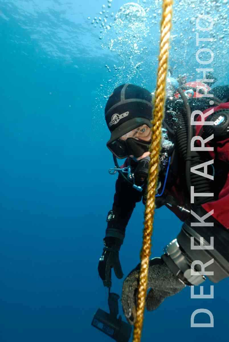 large view of Scuba diver descending on anchor line