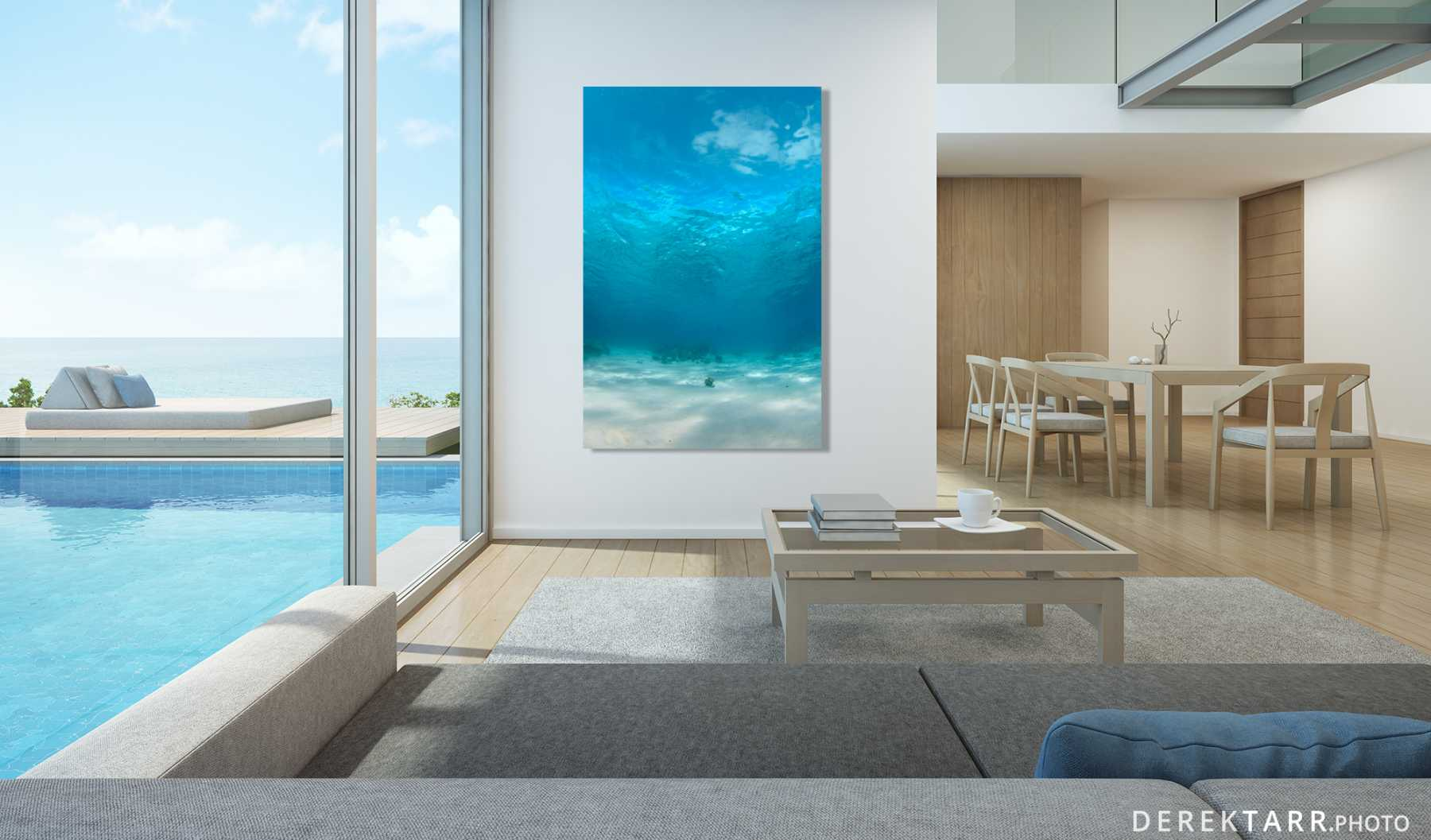 "Fine art print of ""Blue"" shown in a modern interior with a view of a swimming pool and ocean"