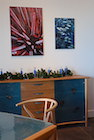 Derek Tarr's fine art prints hanging on the wall in Scan Furniture house